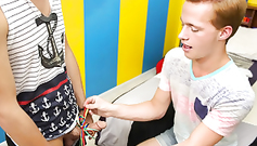 Cute gay is tying boyfriend's dick with bow