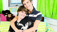 Two teen glamour twinks are posing on the bed